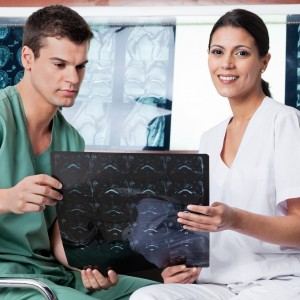 Medical technicians analyzing MRI x-ray of patient at clinic