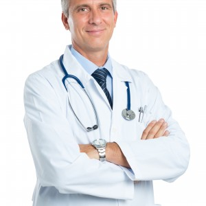 Portrait Of A Confident Mature Doctor Looking At Camera Isolated On White Background