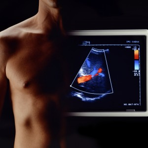 Body of man fused with ultrasound screen